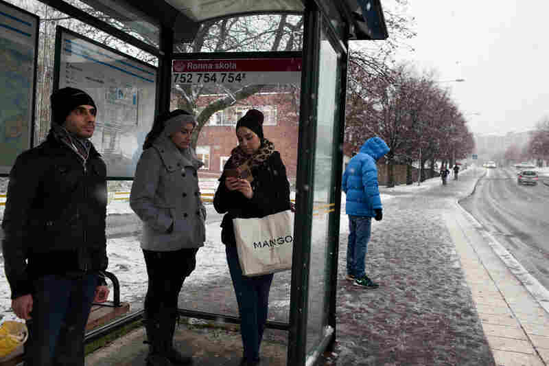 Residents wait at the bus stop in the Ronna neighborhood, where Syrian and Iraqi refugees are concentrated in Södertalje, Sweden. The small Swedish city is known for its open-door policy toward refugees, which is mostly made up of Christian Syrians and Iraqis. People of Middle East origin account for 30,000 of the town's 90,000 residents.