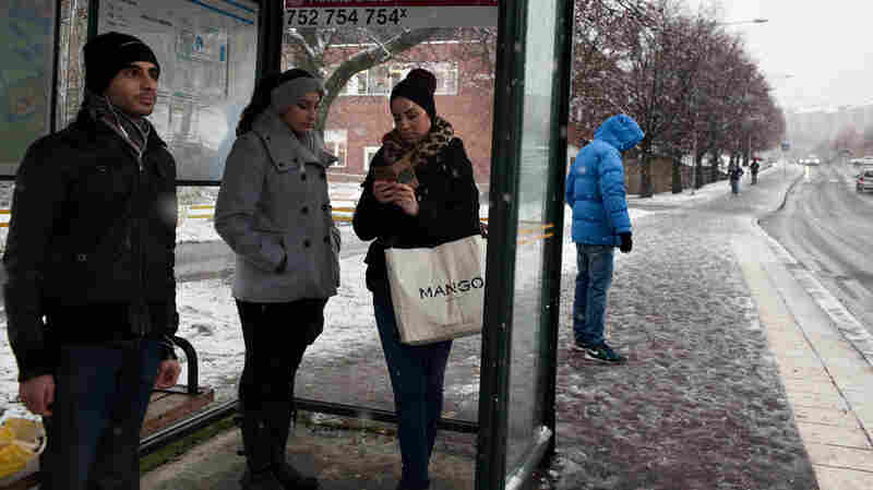 Residents wait at the bus stop in the Ronna neighborhood, where Syrian and Iraqi refugees are concentrated in Södertalje, Sweden. The Swedish city is known for its open-door policy toward refugees, especially Christian Syrians and Iraqis. People of Middle Eastern origin make up 30,000 of the town's 90,000 residents.