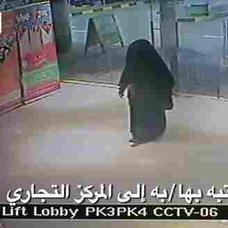 Video footage shows a black-clad suspect at the mall in Abu Dhabi where Monday's stabbing took place.
