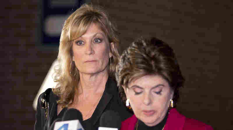 Judy Huth, left, appears at a news conference with attorney Gloria Allred outside the Los Angeles Police Department's Wilshire Division station on Friday. Huth says she was drugged and raped by comedian Bill Cosby in 1974 when she was 15 years old.