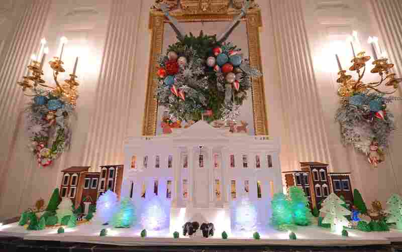 A gingerbread White House sits in the State Dining Room.