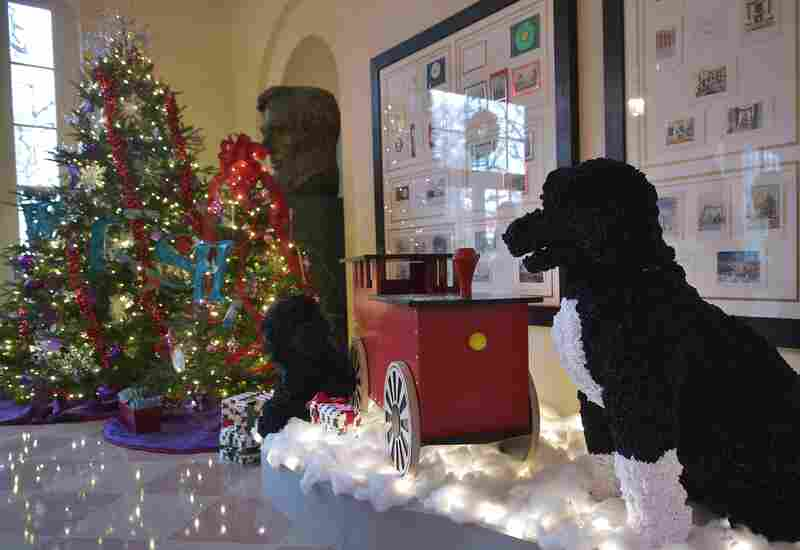 A mechanical Bo (right) and Sonny, life-size versions of the Obama family dogs made of satin ribbon, are stationed in the Bookseller's Room.