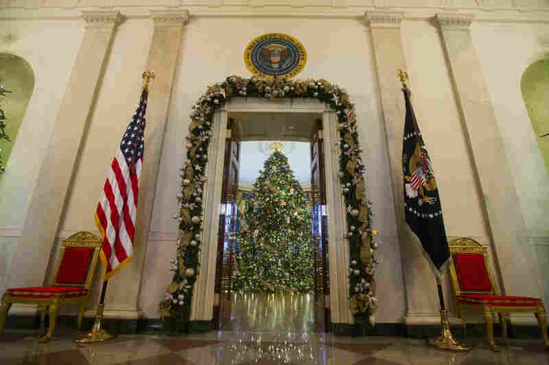A Christmas tree stands in the Blue Room of the White House. About 65,000 people are expected to visit the White House during the holidays.