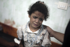 A Palestinian girl cries while receiving treatment at a hospital in the Gaza Strip following shelling in July of a U.N. school in the Jebaliya refugee camp.
