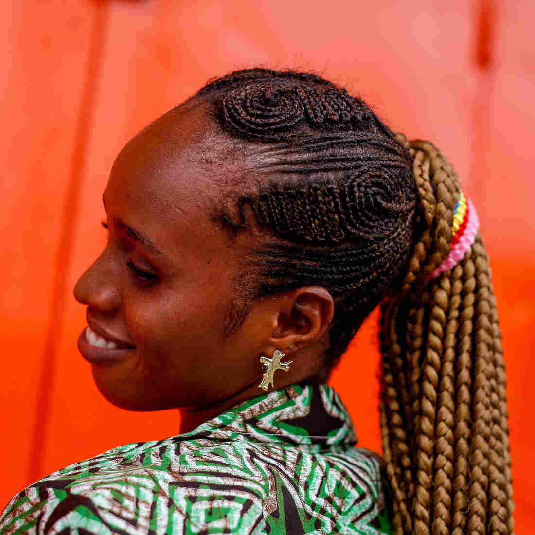 Zoe Kiadi, 25, says neither unemployment nor the presence of Ebola has dimmed her desire to look nice. What really sets her apart is her hairstyle.