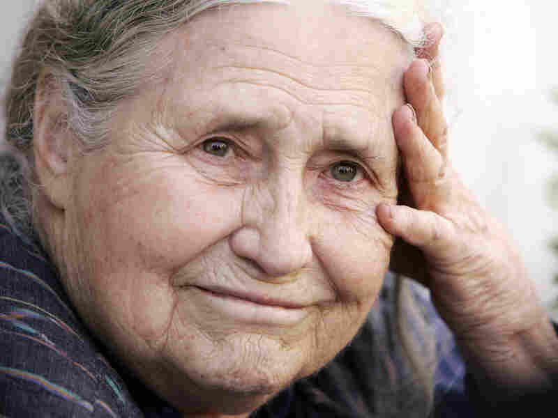Sitting on the steps outside her London home, Doris Lessing learns from reporters that she won the 2007 Nobel Prize in Literature.