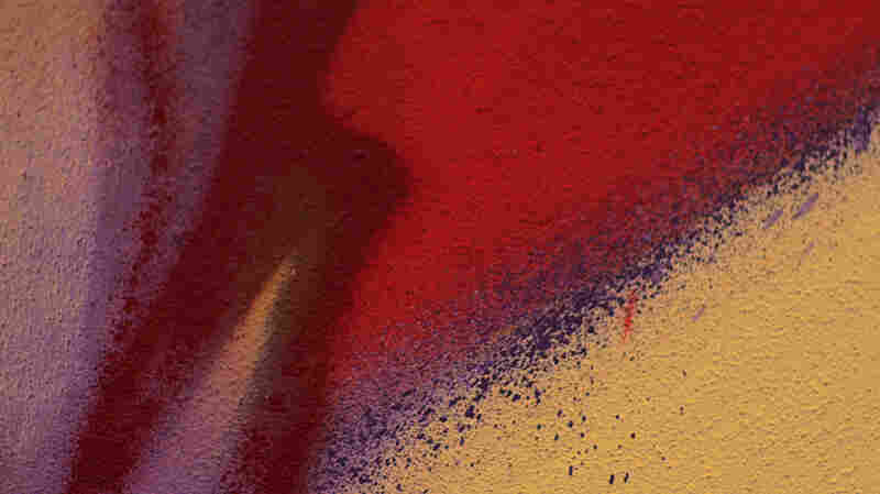 "A still from the video for U2's ""Song for Someone,"" featuring the work of muralist Mode 2."