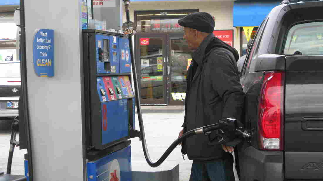 Thomas Harden of Chicago pumps gas into his truck. He says he wouldn't support a gas tax increase.