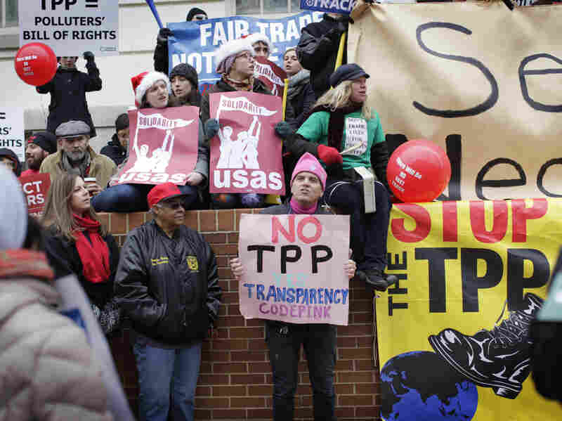 Protesters of varied stripes and political affiliations gathered outside the Office of the U.S. Trade Representative where negotiators from 12 nations were meeting to discuss the Trans-Pacific Partnership.