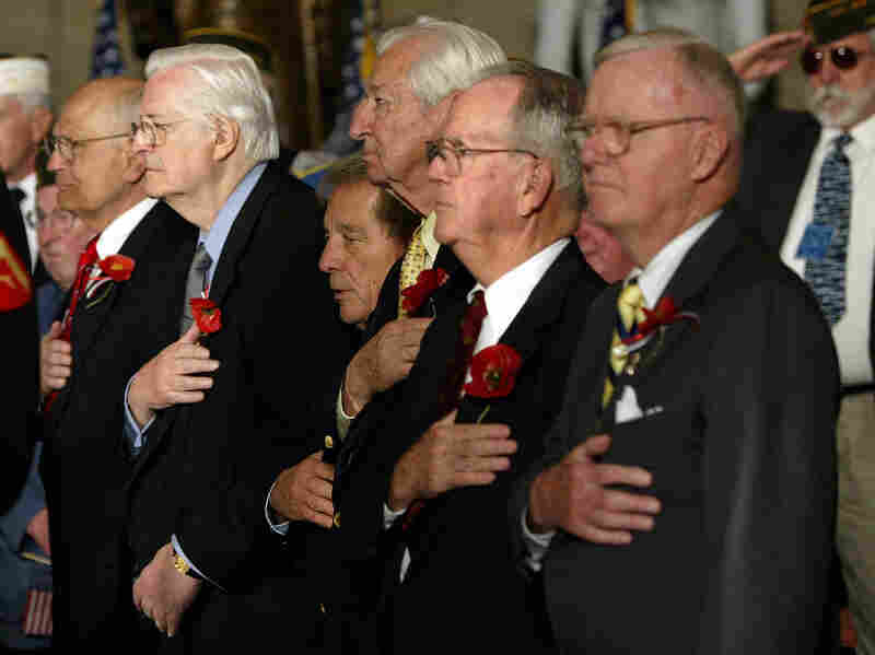 Rep. John Dingell (from left), D-Mich., Rep. Henry Hyde, R-Ill., Rep. Ralph Regula, R- Ohio, Rep. Ralph Hall, D-Tex., Rep. Cass Ballenger, R-N.C., and Rep. Amo Houghton, R-N.Y., stand at a House ceremony honoring World War II veterans in 2004.