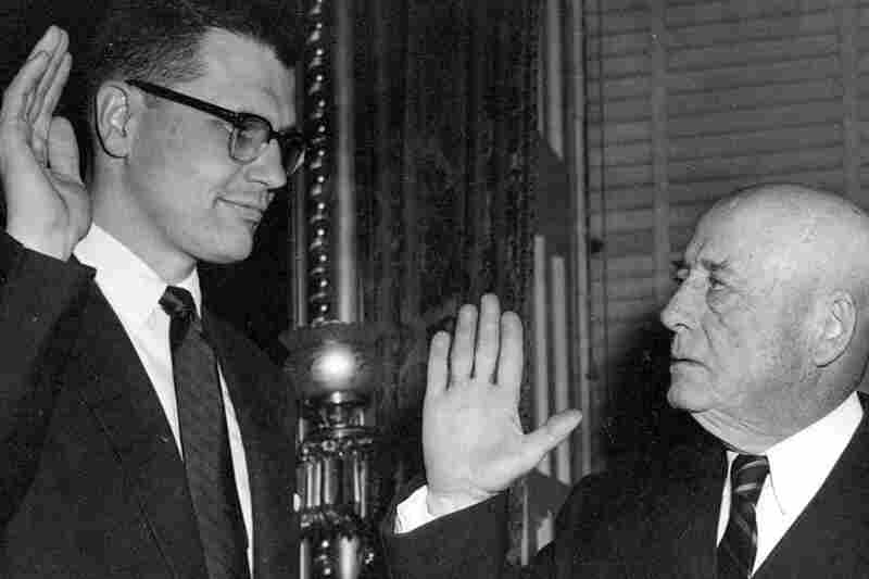 Rep. John Dingell is sworn in by mentor and Speaker of the House Sam Rayburn of Texas in 1955. Dingell decided not to run for re-election this year and described himself and Rep. Ralph Hall, also leaving Congress when his term expires, as the last leaves on the tree.