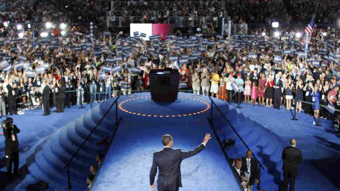 President Obama walks to the podium at his 2008 nominating convention. Lawmakers are inserting into the spending bill a provision allowing political parties to collect up to $97,200 from each donor to pay for their conventions.