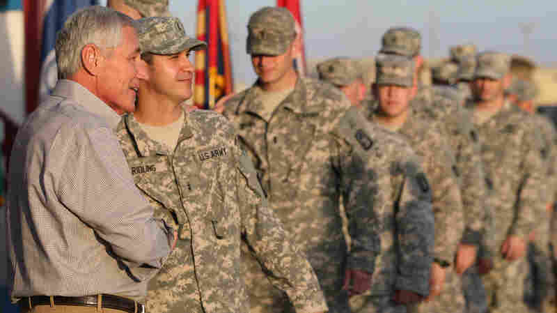 Secretary of Defense Chuck Hagel greets U.S. troops upon his arrival at Camp Buehring, Kuwait, on Monday.
