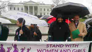 "Bafana Khumalo (in black jacket) carried his fight for ""gender justice"" to the White House today. He called on the U.S. to help fund abortions for women in other countries who've been raped."