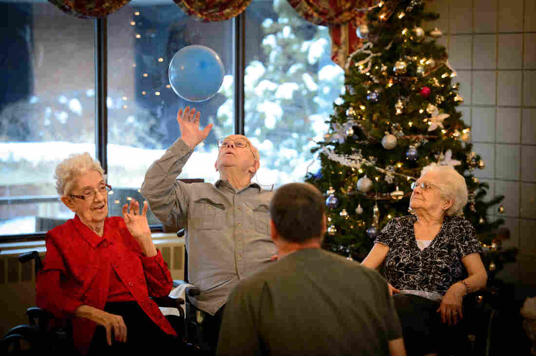 Marian Grunwald (from left), Earl Elfstrom and Verna Matheson bounced a balloon back and forth with nursing assistant Rick Pavlisich on Dec. 13, 2013, at an Ecumen nursing home in Chisago City, Minn.
