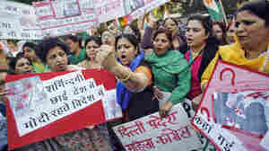 After a woman reported that she was raped by an Uber driver in New Delhi, protesters gathered outside a police station.