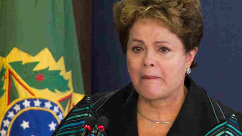 Brazil's President Dilma Rousseff begins to cry as she delivers a speech during the final report of the National Truth Commission on Violation of Human Rights during the military dictatorship from 1964-1985 in Brasilia on Wednesday. She is among the thousands who were tortured during that brutal period.