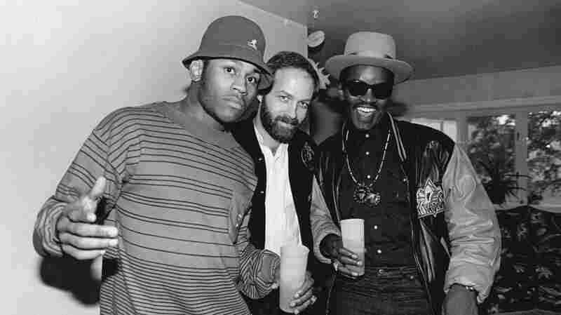 Bill Adler (center) with LL Cool J (left) and Fab 5 Freddy at LL's mother's house in 1988.