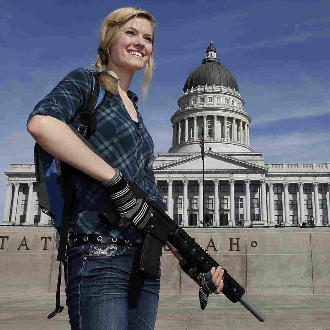 More than half of American women now say owning a gun protects people from becoming victims of crime, according to Pew. Here, a woman carries a rifle at a gun rights rally at the Utah State Capitol last year.
