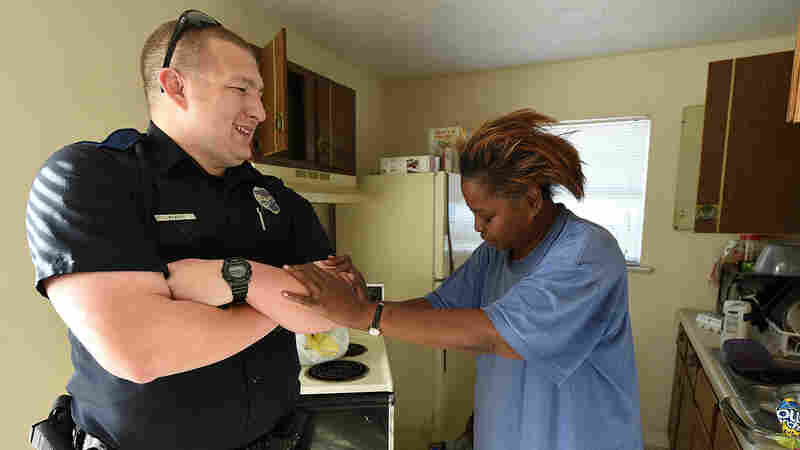 Officer William Stacy with Helen Johnson after donated food was delivered to her. Stacy bought a carton of eggs for Johnson when she was caught stealing eggs from a store in Tarrant, Ala. Johnson says the act of kindness changed her life.