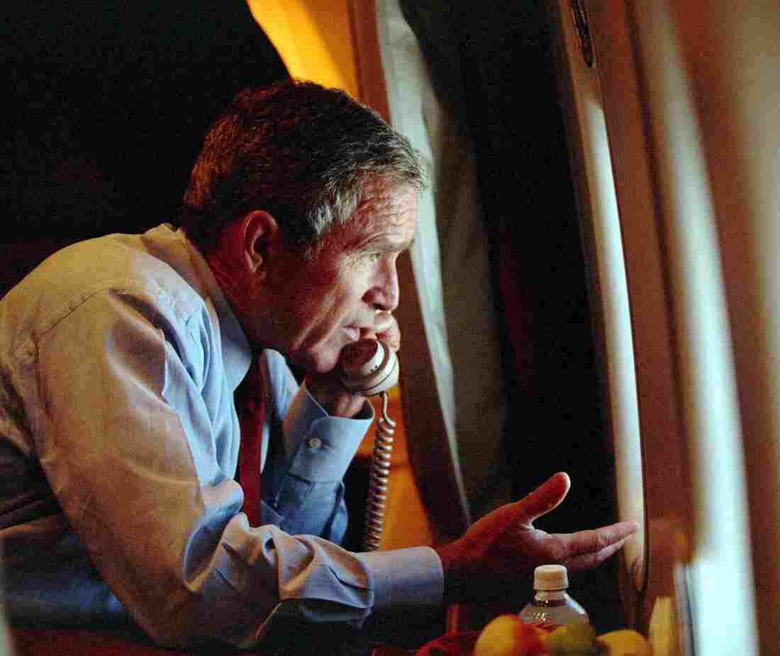 President George W. Bush speaks to Vice President Dick Cheney by phone aboard Air Force One after departing Offutt Air Force Base in Nebraska on Sept. 11, 2001.