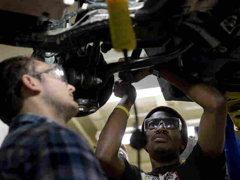 Automotive service technology students work on a car Oct. 23 at the Community College of Philadelphia.