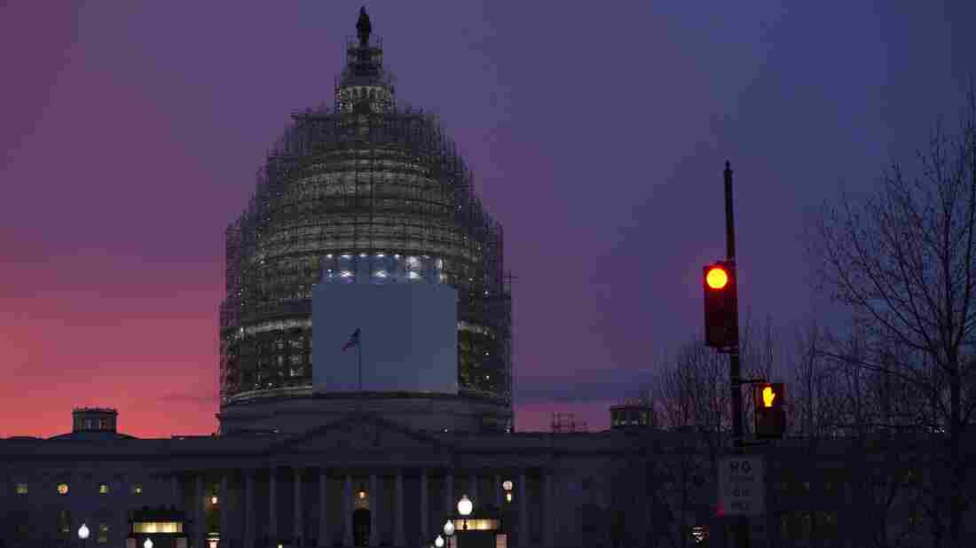 The U.S. Capitol is seen at dusk Thursday. The House approved a massive spending bill just hours before a midnight deadline to fund the federal government.