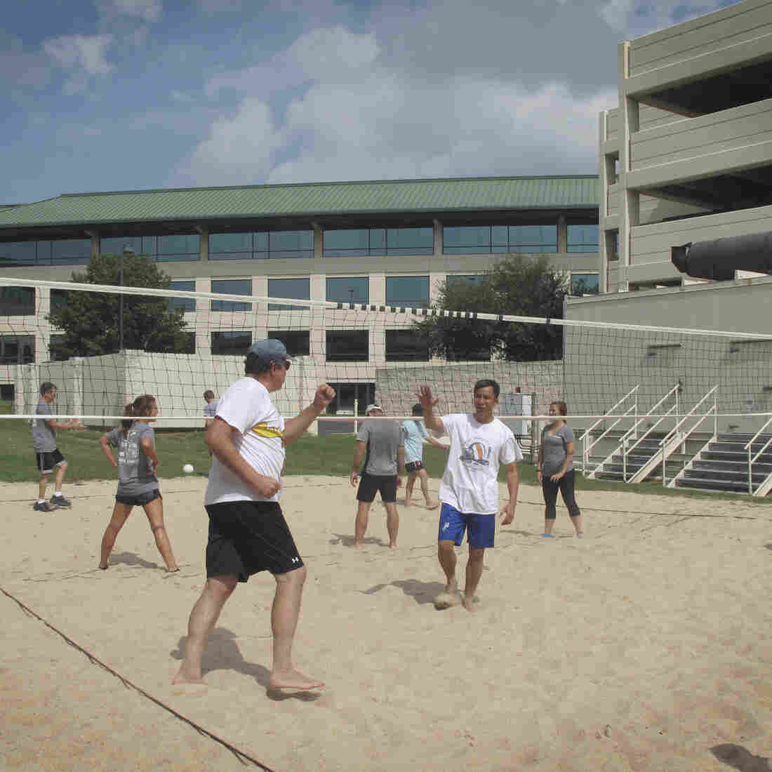 Employees at LifeSize in Austin, Texas, take a midday break to play a game of volleyball. The court was installed to help attract millennials to work for the company.
