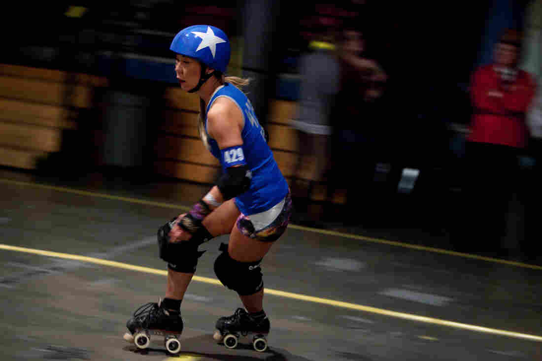 Jammer Elle L. Cool Jam skates around the rink. The jammer's job is to score points for her team.