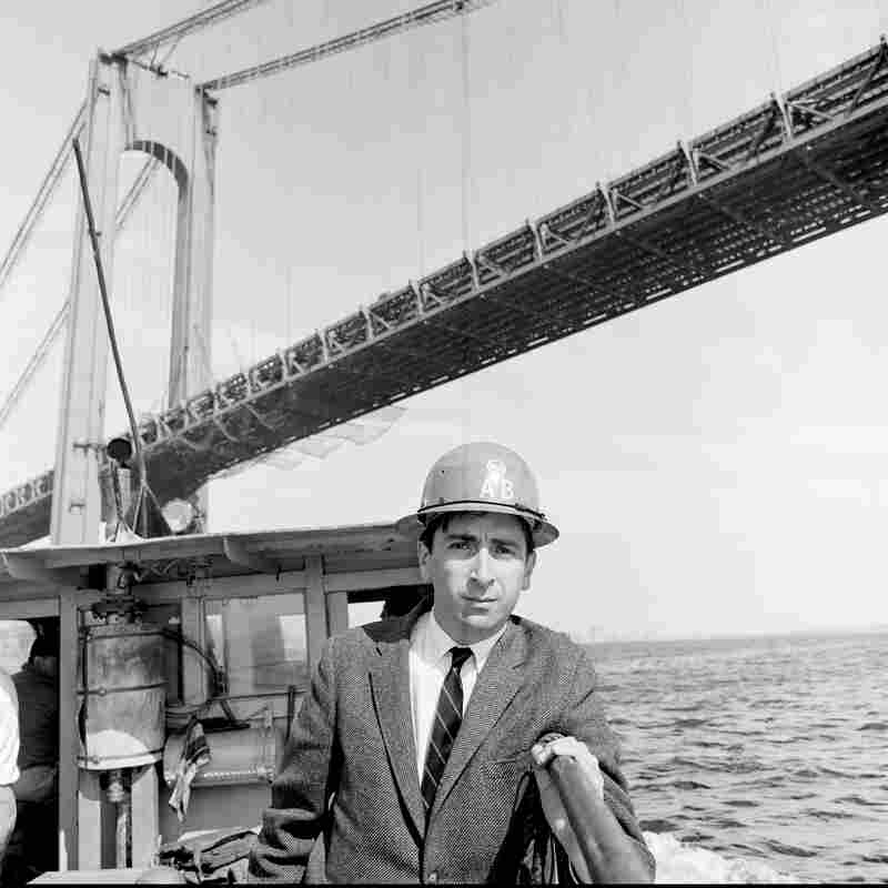 Gay Talese under the Verrazano-Narrows Bridge while reporting on its construction in the early 1960s.