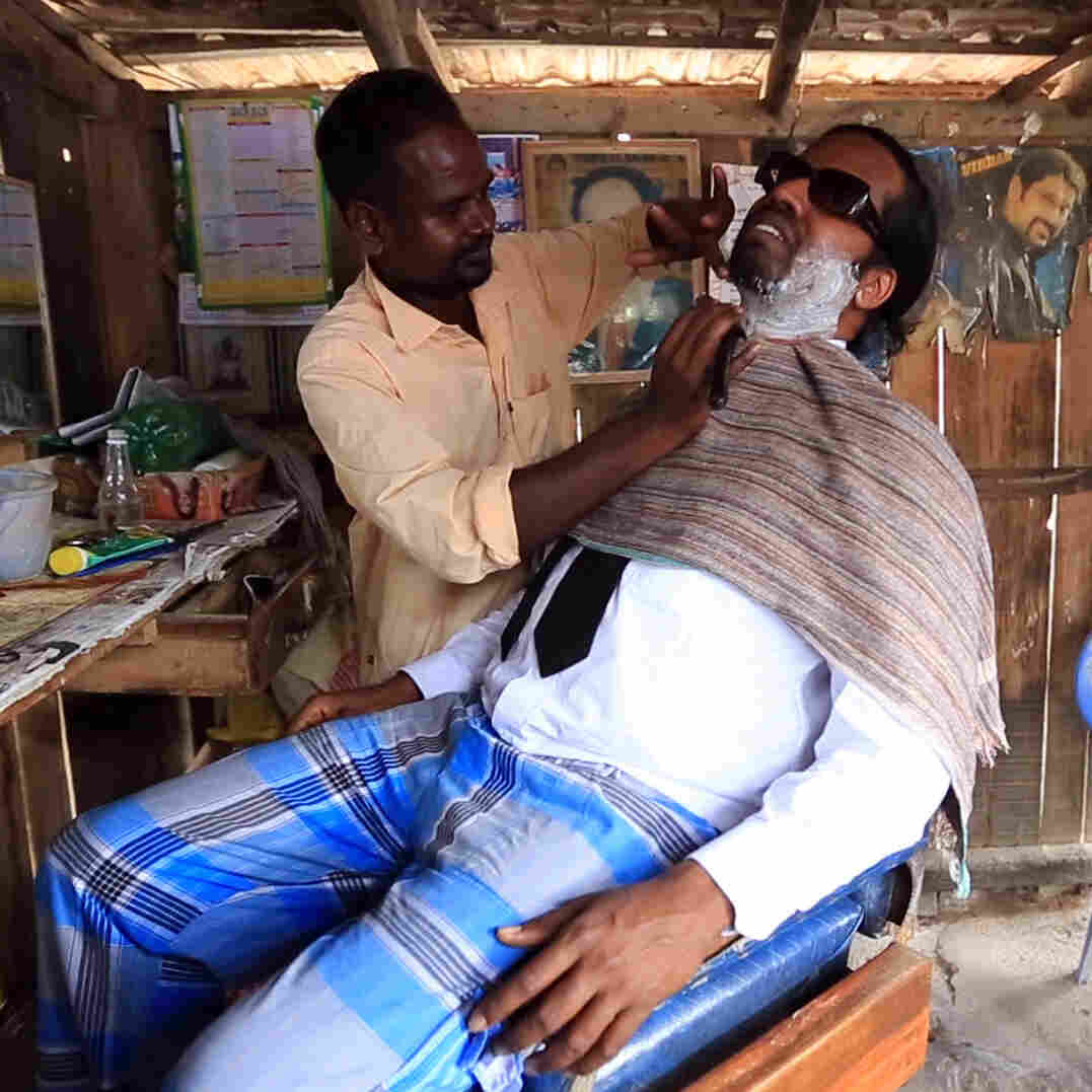 Wilbur Sargunaraj introduces us a barber in his father's home village in India.