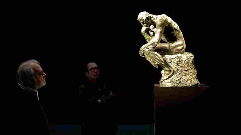 Visitors look at the restored statue The Thinker by Auguste Rodin at the Singer Laren museum in 2011.