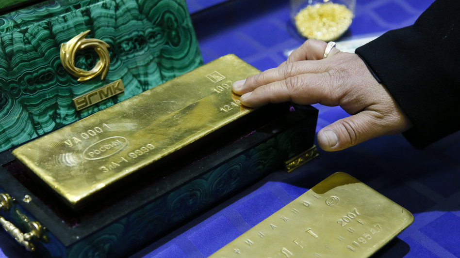 An employee displays a gold bar at a gold refining workshop of the plant of Uralelektromed Joint Stock Company (JSC), the enterprise of Ural Mining and Metallurgical company (UMMC) in the town of Verkhnyaya Pyshma, outside Yekaterinburg, Oct. 17. (Maxim Shemetov/Reuters/Landov)