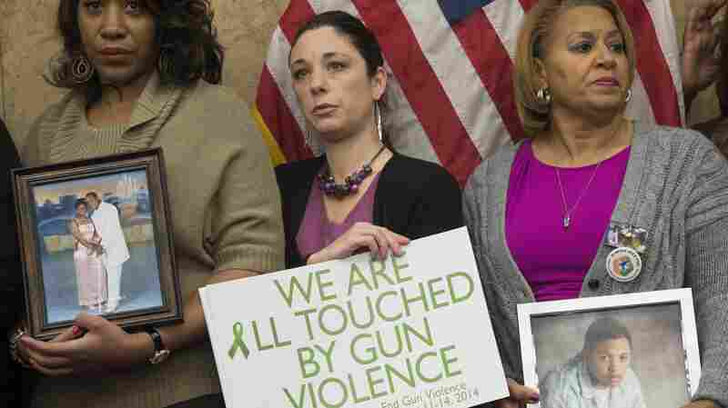 Relatives of victims of gun violence attend a press conference honoring the second anniversary of the Sandy Hook Elementary School shootings in Washington, D.C. on Dec. 10, 2014.