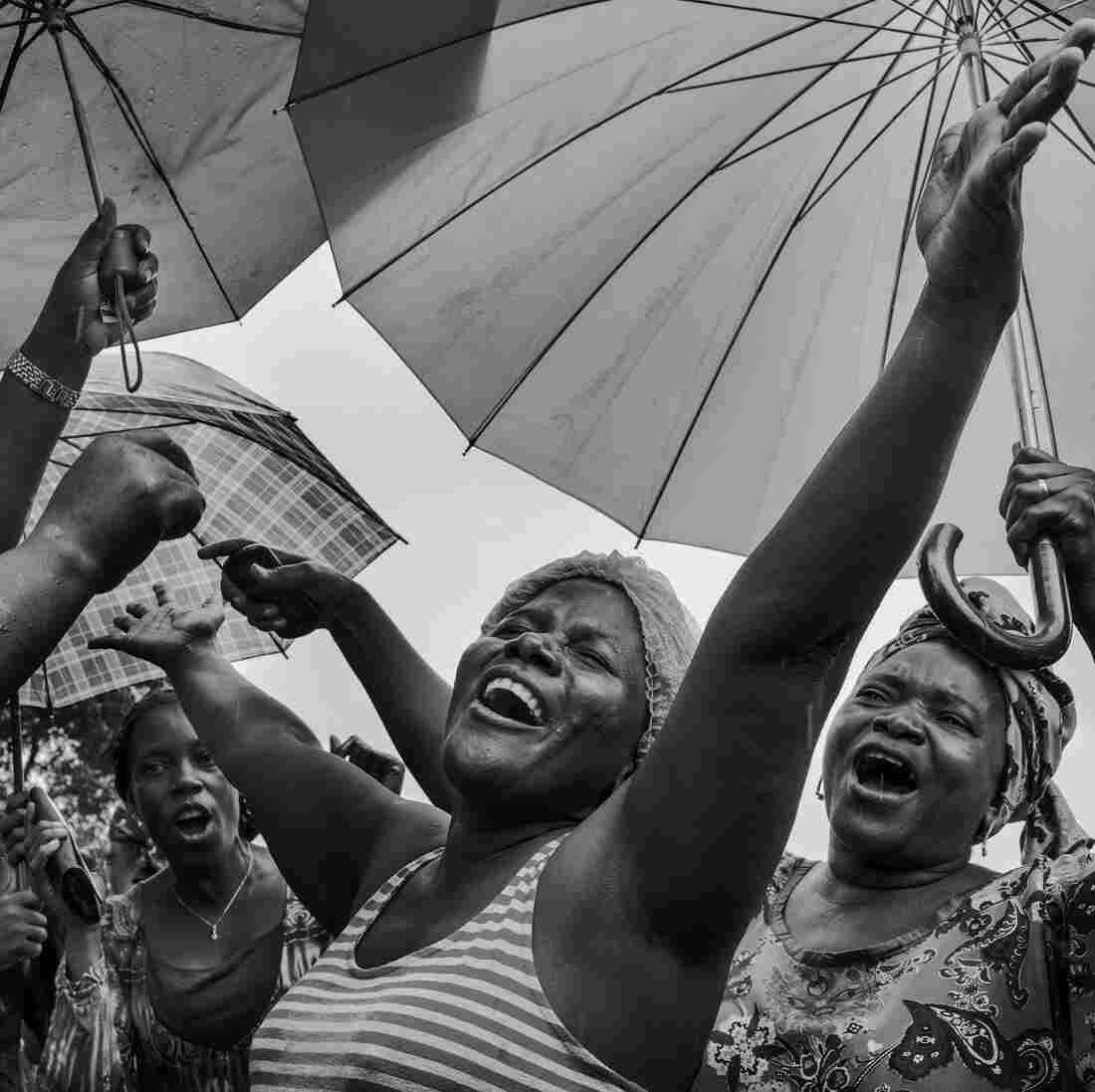 Ebola survivor Klubo Mulbah (center), a physician assistant who was infected by a patient, celebrates among friends and family on Sept. 24 in Monrovia, Liberia. She was among 15 Liberian patients who recovered from Ebola and were released from the ELWA 2 ebola treatment center.