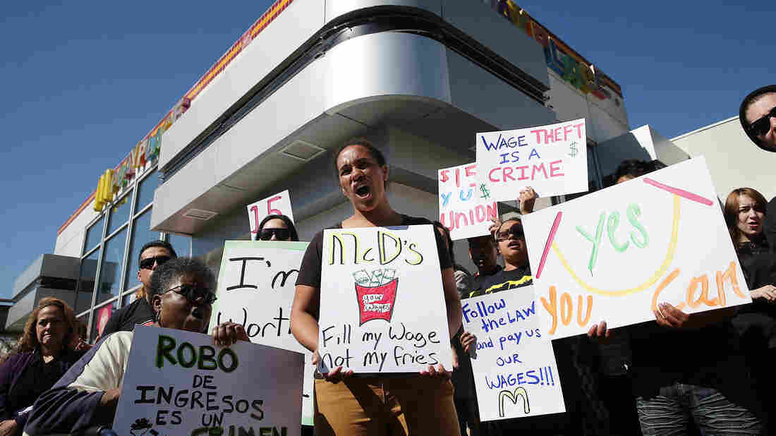 Fast-food workers and activists protest outside a McDonald's restaurant on March 18 in Oakland, Calif., as part of a nationwide series of protests against McDonald's labor practices.