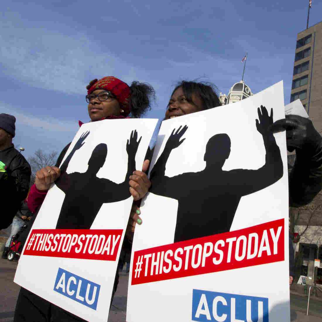"Melissa W. Green, right, and her daughter Reshae Green holds up their signs at Freedom Plaza during the ""Justice for All"" march and rally on Pennsylvania Avenue in Washington on Saturday."