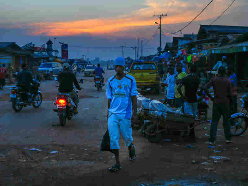The main street in Ganta, Liberia, at dusk.