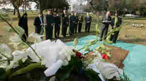 LA County has held a ceremony for the unclaimed dead since 1896. In this photo from 2005, Albert Gaskin (far right) reads prayers as the cremated remains of more than 1,600 people are buried.