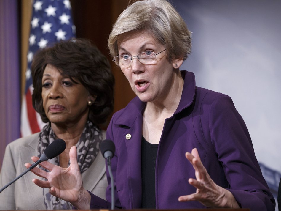 Sen. Elizabeth Warren, D-Mass. (right), a member of the Senate banking committee, and Rep. Maxine Waters, D-Calif., ranking member of the House financial services committee, express their outrage to reporters that a $1.1 trillion spending bill that was passed in Congress contains changes to the 2010 Dodd-Frank law that regulates complex financial instruments known as derivatives.