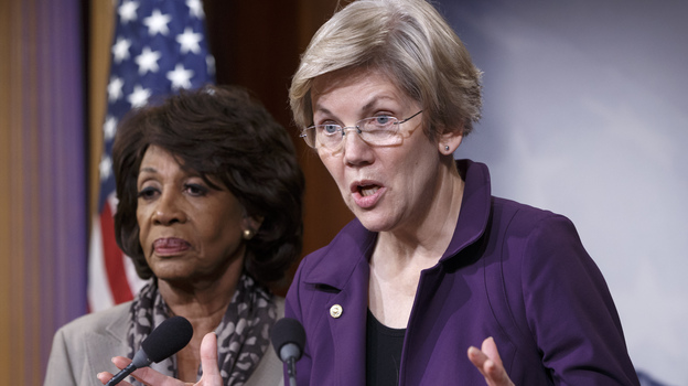 Sen. Elizabeth Warren, D-Mass. (right), a member of the Senate banking committee, and Rep. Maxine Waters, D-Calif., ranking member of the House financial services committee, express their outrage to reporters that a $1.1 trillion spending bill that was passed in Congress contains changes to the 2010 Dodd-Frank law that regulates complex financial instruments known as derivatives. (AP)