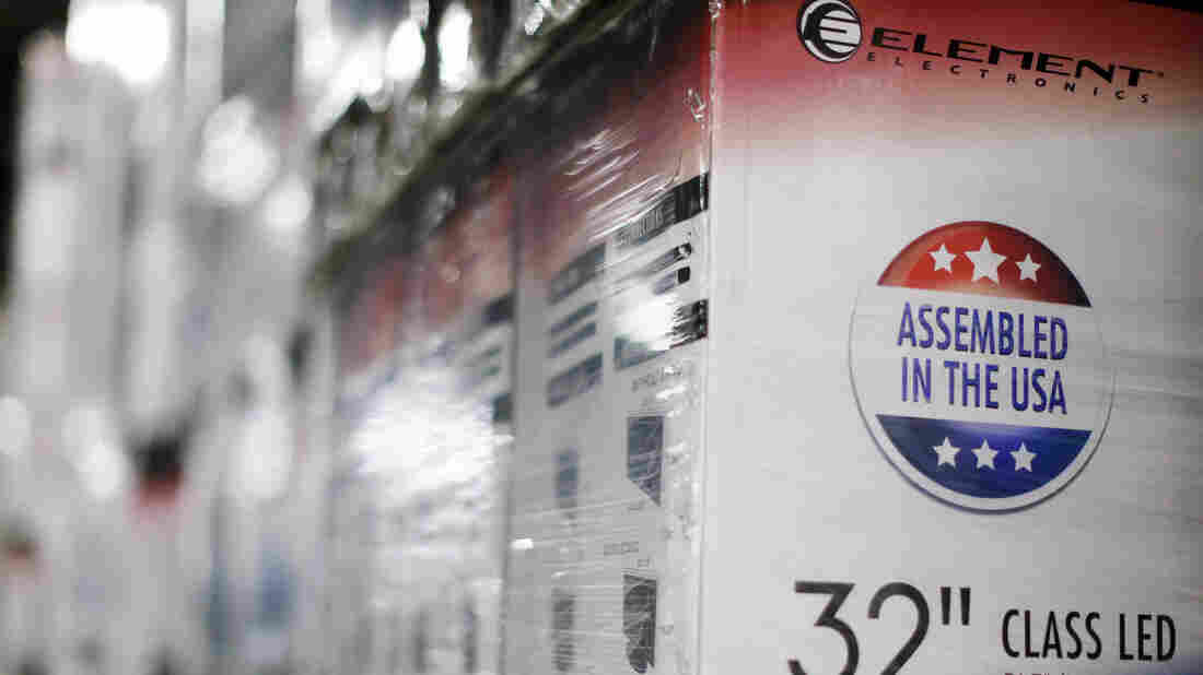 "An ""Assembled in the USA"" stamp is seen at the side of a box containing a 32-inch television set May 29 in the warehouse of Element Electronics, in Winnsboro, S.C. For the phenomenon of ""reshoring,"" or bringing overseas jobs back to the United States, the electronics sector has been a leader."