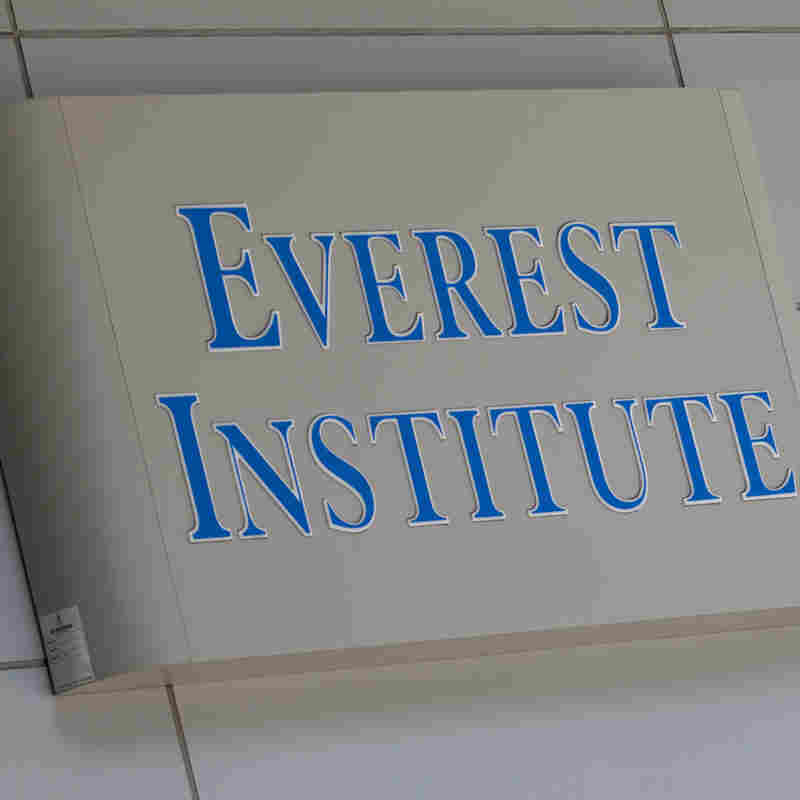 A person walks past an Everest Institute sign in an office building in Silver Spring, Md., on July 8.