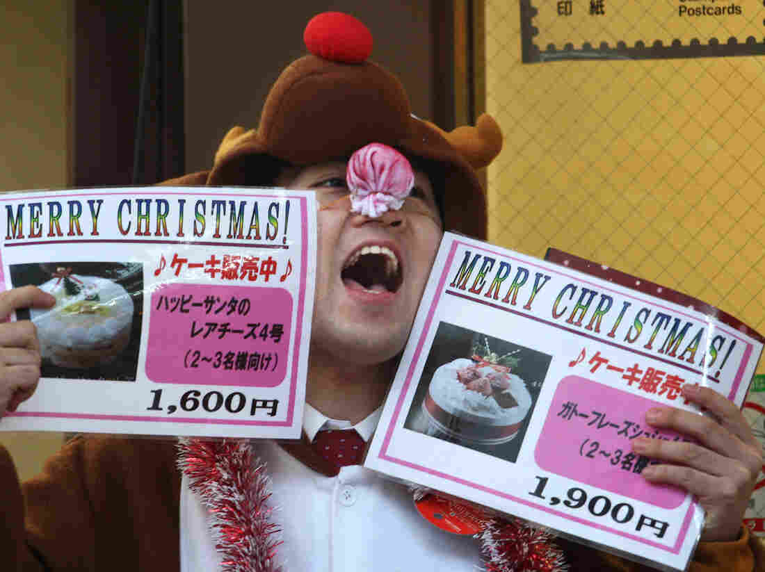 A man in a reindeer costume hawks Christmas cake outside a bakery in Kobe, Japan, Dec. 23, 2011.