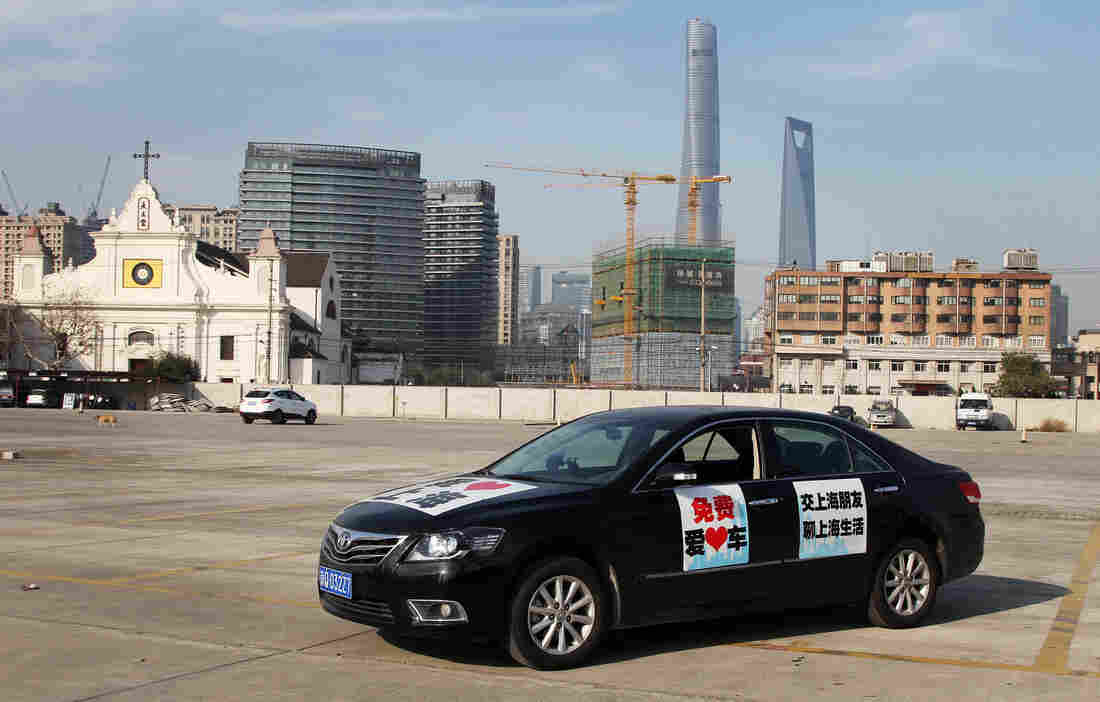 NPR Shanghai correspondent Frank Langfitt put signs on his Toyota Camry saying he would give passengers free rides around Shanghai in exchange for their stories about the bustling city. He has found plenty of takers.
