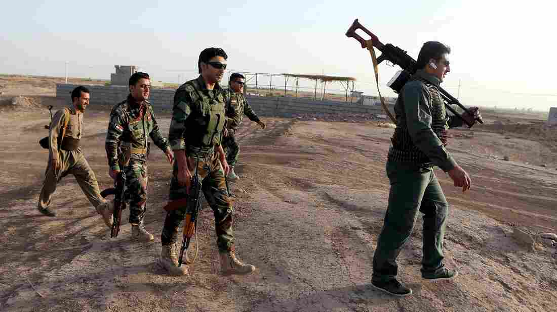 Iraqi Kurdish Peshmerga fighters take up positions in September around Gwer, in northern Iraq, as part of their fight against the Islamic State. Kurdish forces are now trying to prevent young Kurdish men from cities like Halabja from joining the Islamic State.