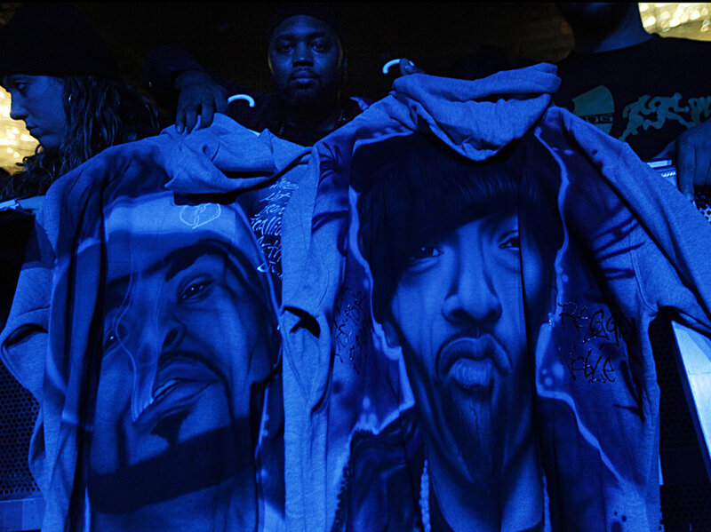 Wilanthonys, of Syracuse, New York, holds two hoodies he airbrushed with the likenesses of Method Man and Redman as he waits for them to take the stage at Best Buy Theater on Nov. 26th, 2014.