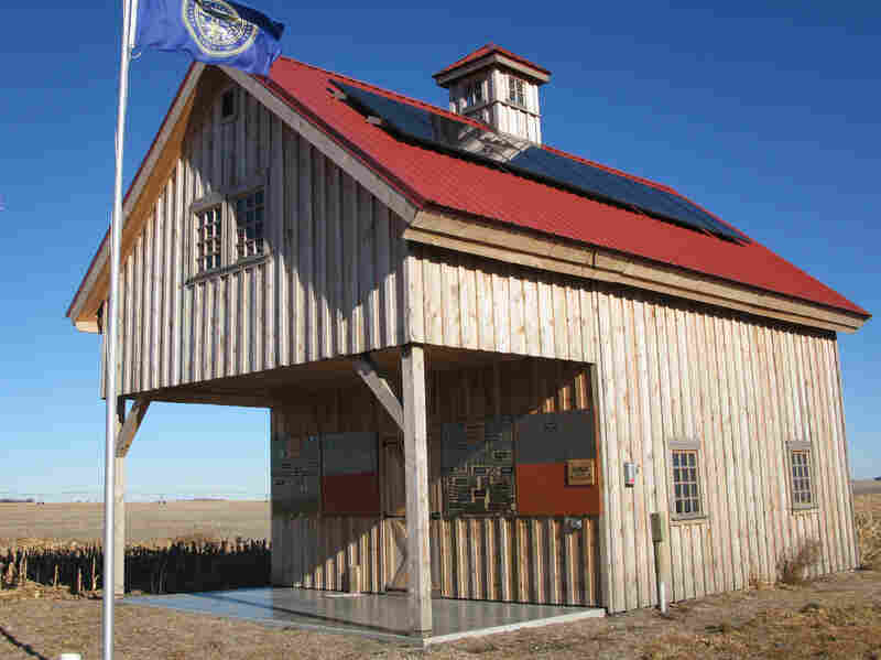 """Pipeline opponents built the """"Energy Barn,"""" with its solar panels and windmill, in 2013. They constructed the barn as a symbol of renewable energy — right on the pipeline's proposed route."""