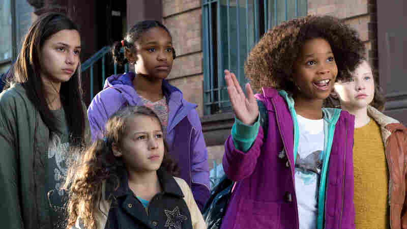 Quvenzhane Wallis (second from right) stars in an updated version of Annie, produced by Jay Z.