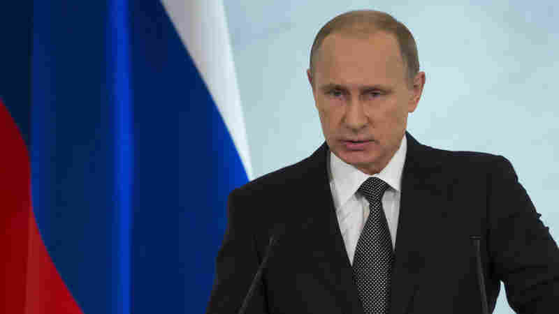 Russian President Vladimir Putin, shown delivering his state of the union speech earlier this month, was riding high this year as the country hosted the Winter Olympics. Russia is now embroiled in economic turmoil, and Putin has alienated Western countries that could potentially help.